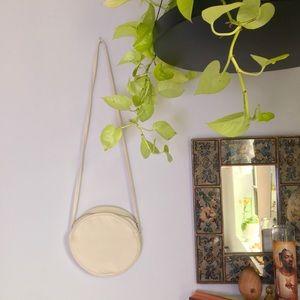 BAGGU cream canvas circle cross body bag